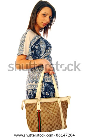 A beautiful and sexy brunette goes shopping - stock photo