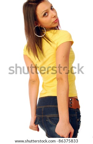 A beautiful and sexy brunette in a yellow T-shirt - stock photo