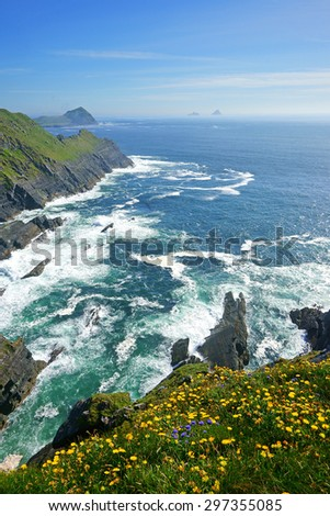 A beautiful and stunning view of the Kerry Cliffs, the Skelligs and Penguin Island can be seen in the distance, The Ring of Kerry, Ireland - stock photo