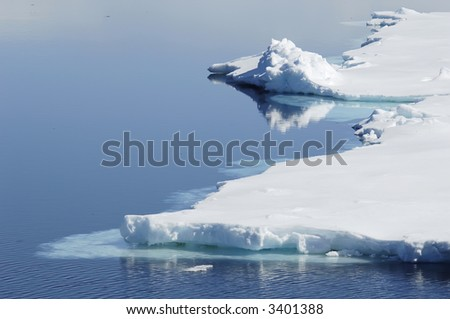 A beautiful Antarctic icescape in sunlight. Picture was taken during a 3-month Antarctic research expedition near the Peninsula. - stock photo