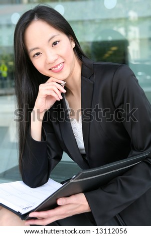 A beautiful asian business woman in office building - stock photo