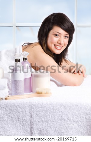 A beautiful asian girl getting ready for a spa treatment in a beauty salon - stock photo