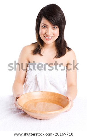 A beautiful asian girl getting ready to wash her face at a spa - stock photo