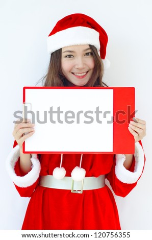 A Beautiful Asian santa woman in red cloth with copyspace.