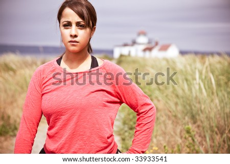A beautiful asian woman exercises in a park