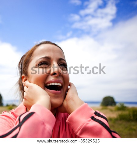 A beautiful asian woman happy in joy - stock photo