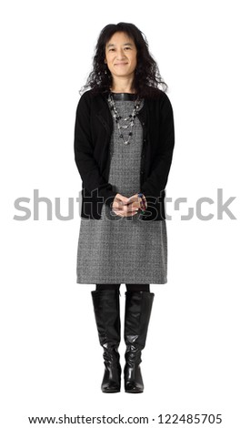 A beautiful Asian woman in dressy business attire isolated on white