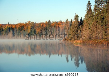 A beautiful autumn's landscape in the morning with fog and mist