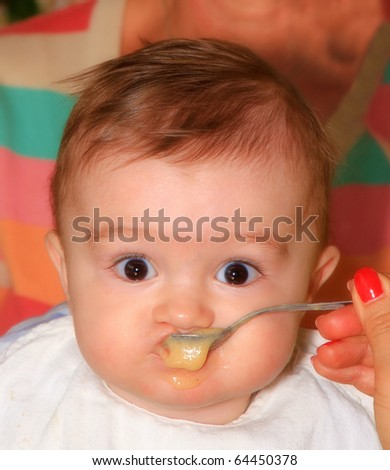 A beautiful baby eating