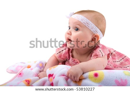 A beautiful baby girl looking at blank copy space isolated on a white background