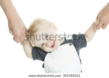 A Beautiful  baby learning to walk isolated on a white background