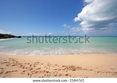 A beautiful beach in Antigua - stock photo