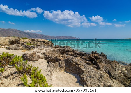 A beautiful beach on a Greek island in summer - stock photo