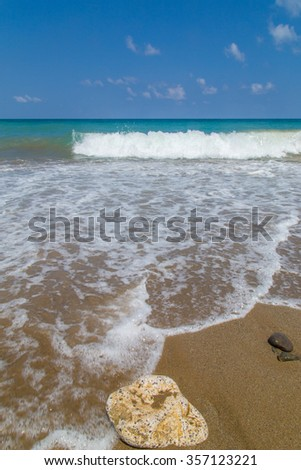 A beautiful beach on a Greek island in summer, on a sunny and windy day