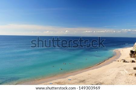 A beautiful beach on a hot and sunny day, Dreamland beach, Bali.  - stock photo