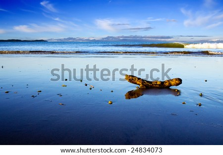 A beautiful beach scene at dusk, Taipa Beach, Northland, New Zealand - stock photo
