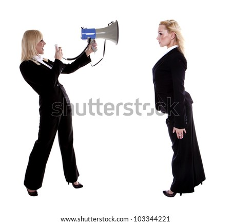 A beautiful blond businesswoman shouting trough a megaphone at herself. Who is the boss of who?
