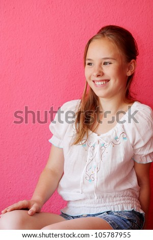 A beautiful blond-haired 13-years old girl, portrait - stock photo