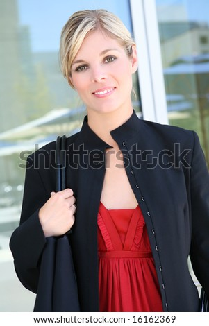 A beautiful blonde business woman outside her office building