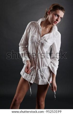 A beautiful blonde girl posing in a studio - stock photo