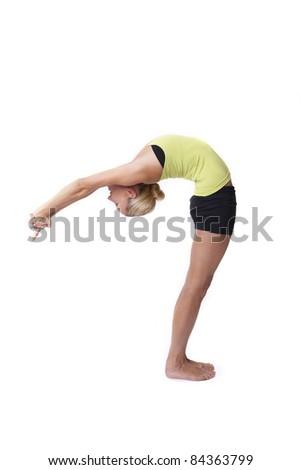 A beautiful blonde woman in yoga pose - stock photo
