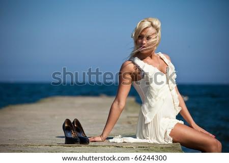 a beautiful blonde woman on the beach - stock photo