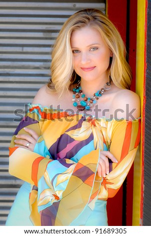 A beautiful blonde woman wearing colorful clothing - stock photo
