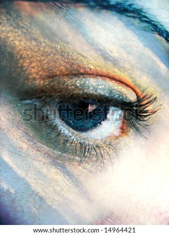 A beautiful blue eye concept with the colors of the sky added. - stock photo