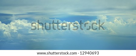 A beautiful blue sky filled with building white clouds