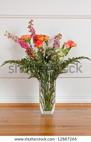 A beautiful bouquet of flowers in a crystal vase. - stock photo