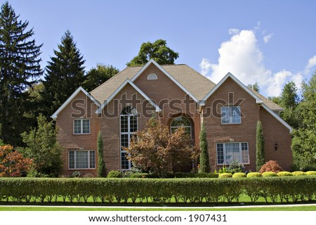 A beautiful brick family home in the suburbs of Cleveland, Ohio. - stock photo