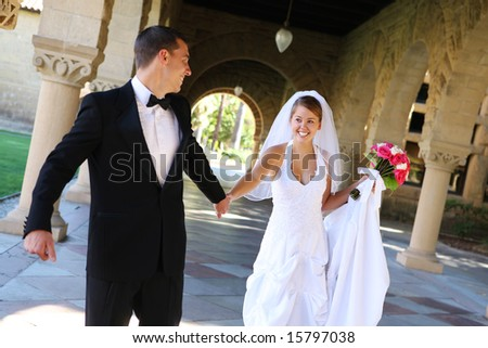 A beautiful bride and groom  at church wedding - stock photo