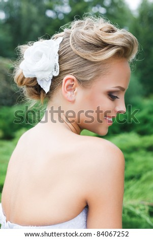 A beautiful bride in the white wedding dress. - stock photo