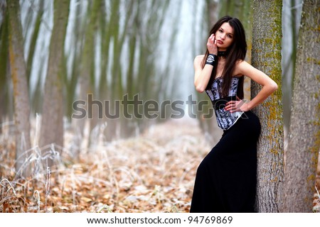 A beautiful brunette woman posing in the winter.Art photo. - stock photo