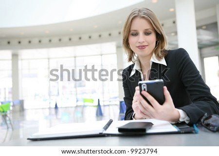 A beautiful business woman holding a electronic technology organizer - stock photo