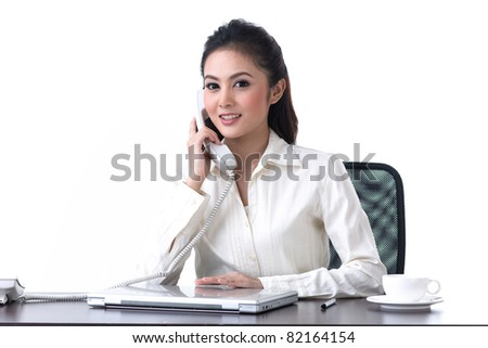 A beautiful business woman talking on the phone - stock photo