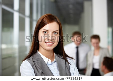 A beautiful businesswoman looking at camera with smile