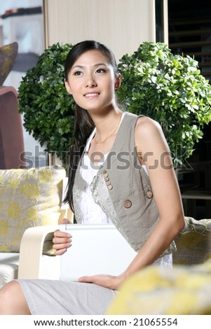 a beautiful businesswoman working on her laptop at home - stock photo