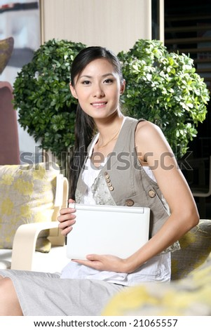 a beautiful businesswoman working on her laptop at home