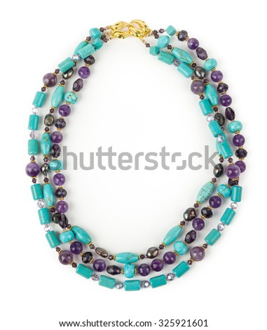 A beautiful calaite and amethyst necklace on white background. - stock photo