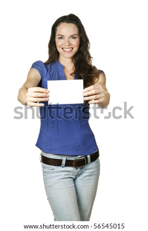 A beautiful casual young woman holding a blank business card in front of her.