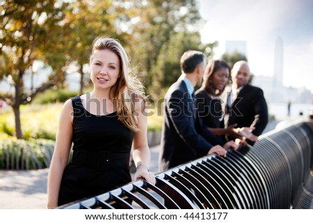 A beautiful caucasian business woman in an outdoor setting - stock photo