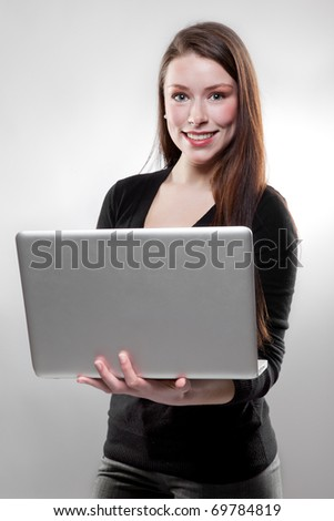 A beautiful caucasian businesswoman holding her laptop