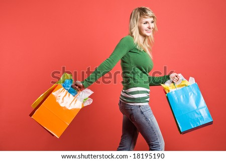 A beautiful caucasian girl carrying shopping bags
