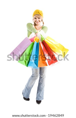 A beautiful caucasian girl carrying shopping bags - stock photo