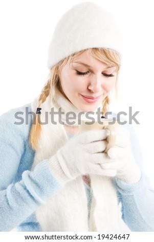 A beautiful caucasian girl drinking hot coffee - stock photo