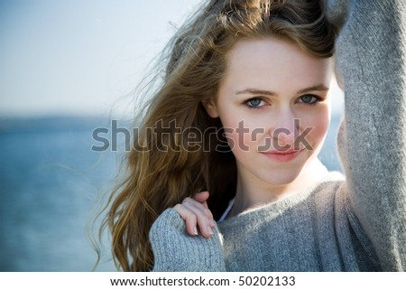 A beautiful caucasian girl outdoor on the beach during summer - stock photo