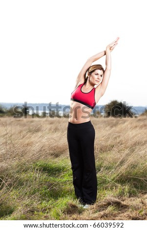 A beautiful caucasian woman practicing yoga outdoor in a park - stock photo