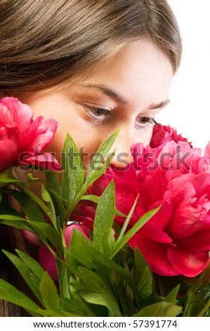 A beautiful caucasian woman smell red rose - stock photo