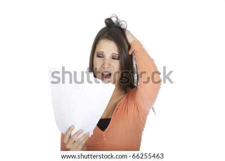 A beautiful Caucasian woman upset about incoming bills - stock photo